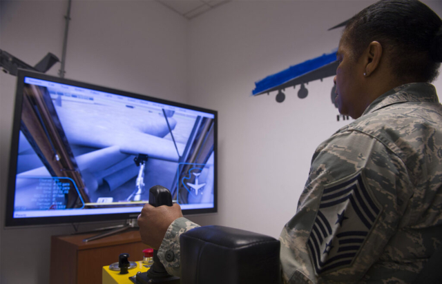 Chief Master Sgt. Shelina Frey Air Mobility Tests Deicing Simulator