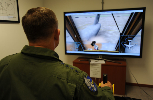 US Air Force General Gorenc Operates Aircraft Deicing Simulator